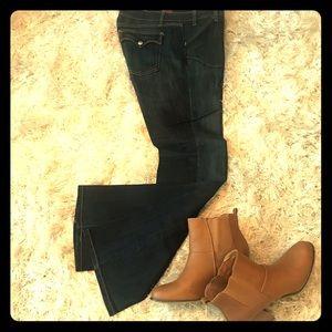 Levi's - super low, slim leg bootcut. Dark blue.